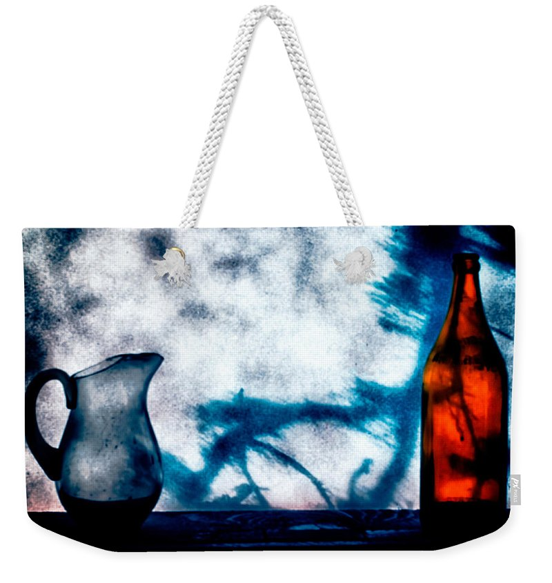 Still-life Weekender Tote Bag featuring the photograph One Red Bottle by Bob Orsillo