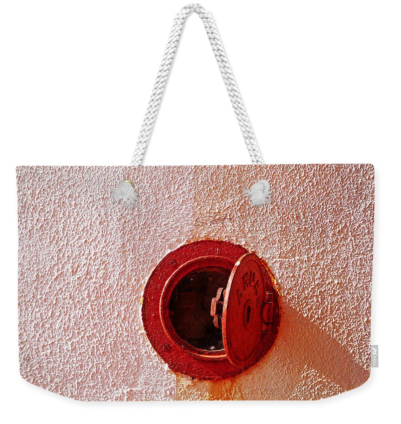 Red Weekender Tote Bag featuring the photograph Open by Charles Stuart