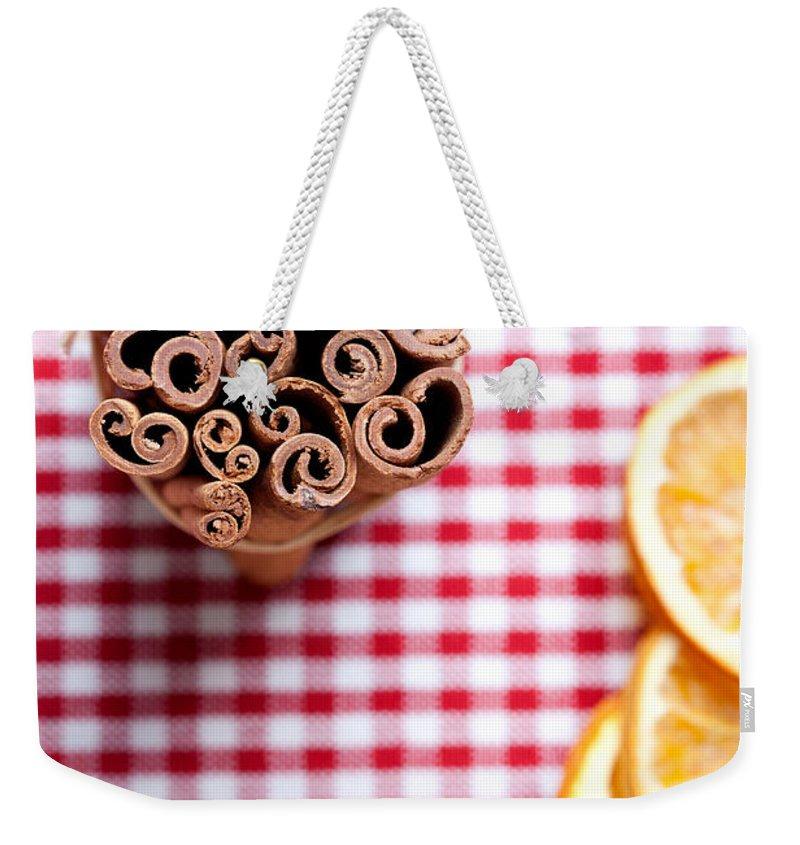 Orange Weekender Tote Bag featuring the photograph Orange And Cinnamon by Nailia Schwarz
