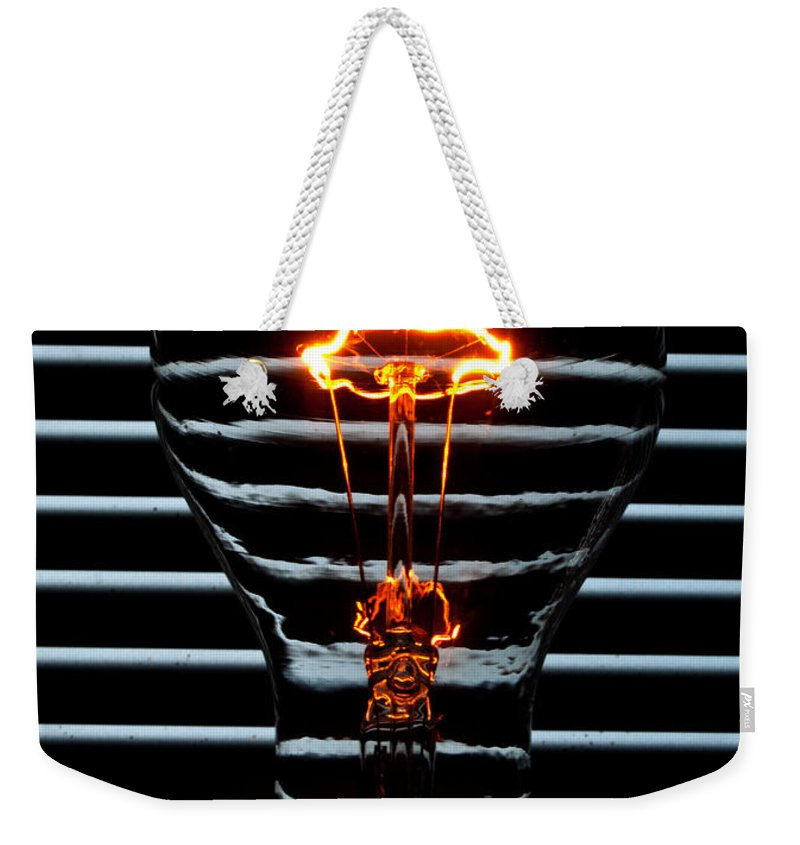 Orange Weekender Tote Bag featuring the photograph Orange Bulb by Rob Hawkins
