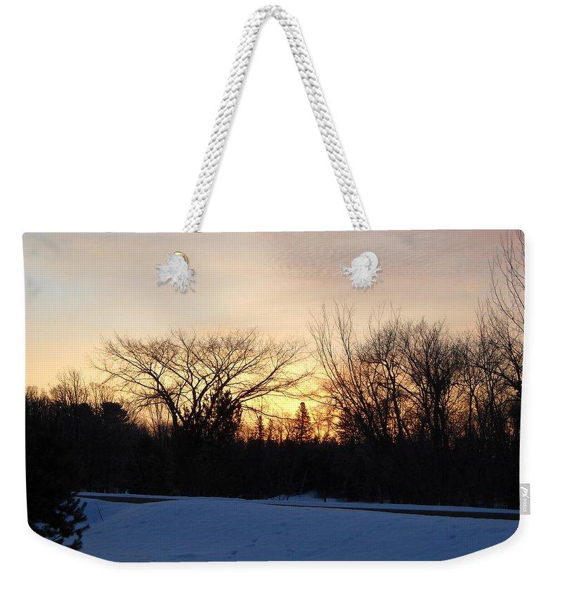 Sky Weekender Tote Bag featuring the photograph Orange Dawn Sky Behind Trees by Kent Lorentzen