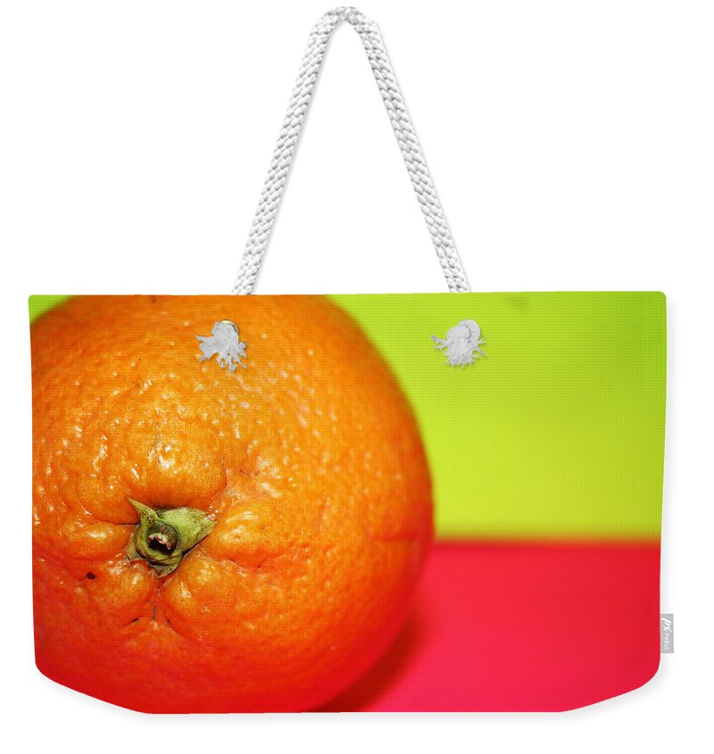Oranges Weekender Tote Bag featuring the photograph Orange by Linda Sannuti