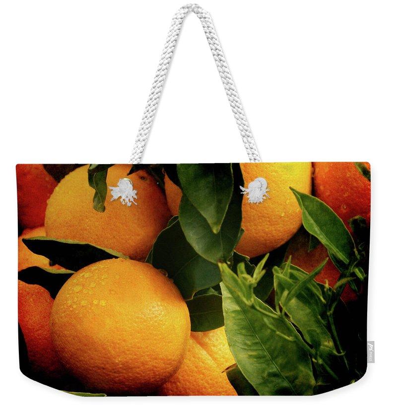 Oranges Weekender Tote Bag featuring the photograph Oranges by Ernie Echols