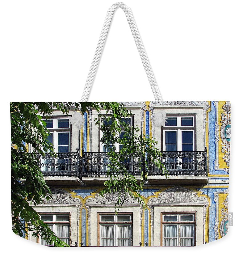 Lisbon Weekender Tote Bag featuring the photograph Ornate Building Facade In Lisbon Portugal by Carla Parris