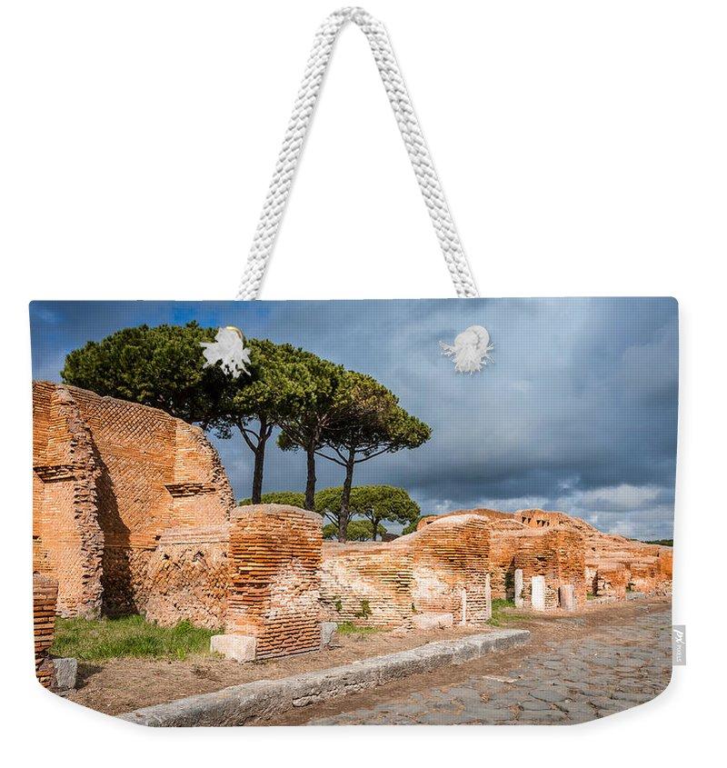Ostia Antica - Strolling The Decuman Weekender Tote Bag featuring the photograph Ostia Antica - Strolling The Decuman by Debra Martz
