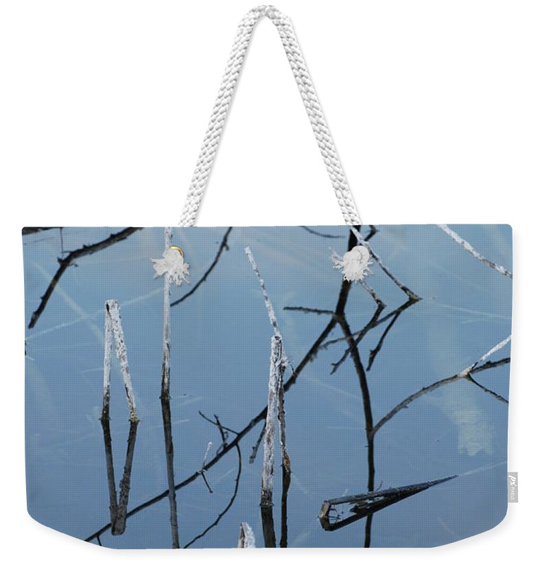 Wood Weekender Tote Bag featuring the photograph Out From The Water by Rob Hans