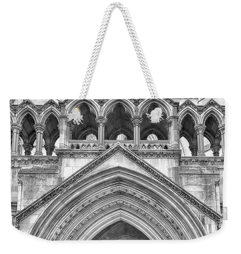 London Weekender Tote Bag featuring the photograph Over The Entrance To The Royal Courts by Shirley Mitchell
