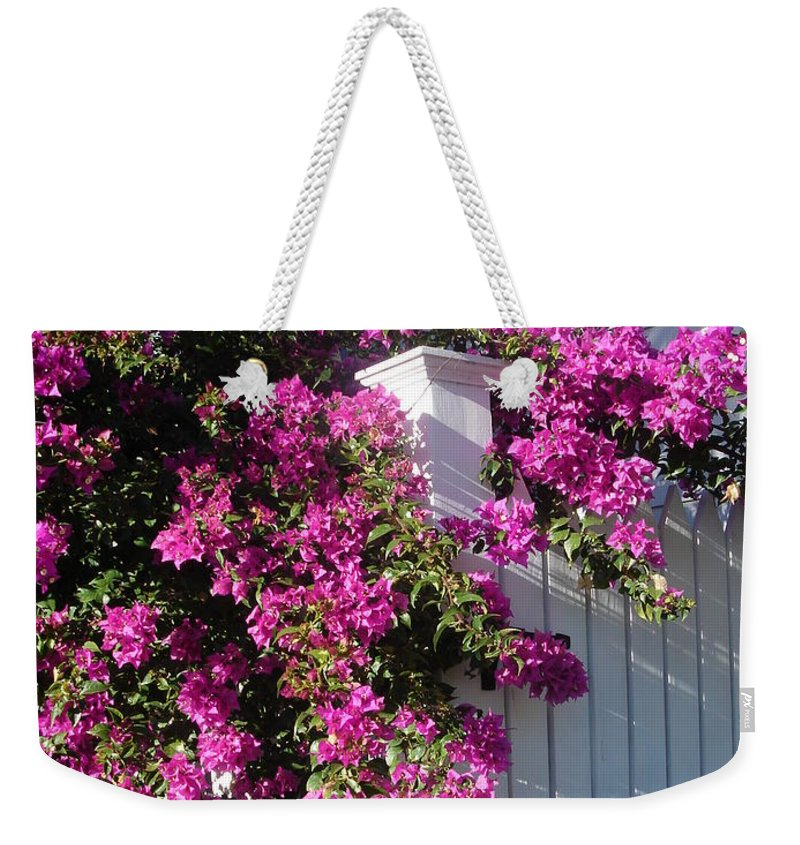 Flower Weekender Tote Bag featuring the photograph Over The Fence by Susanne Van Hulst