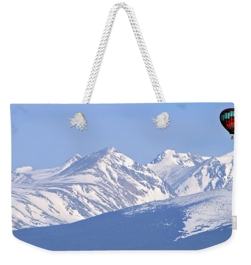 Rockies Weekender Tote Bag featuring the photograph Over The Rockies by Scott Mahon