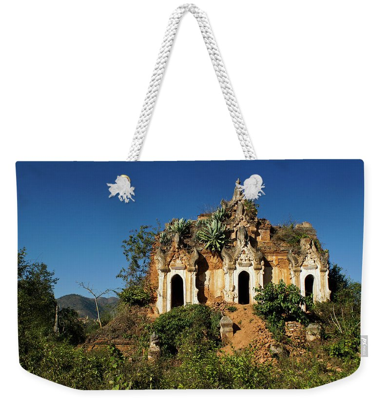 Asia Weekender Tote Bag featuring the photograph Pagoda In Ruins by Michele Burgess