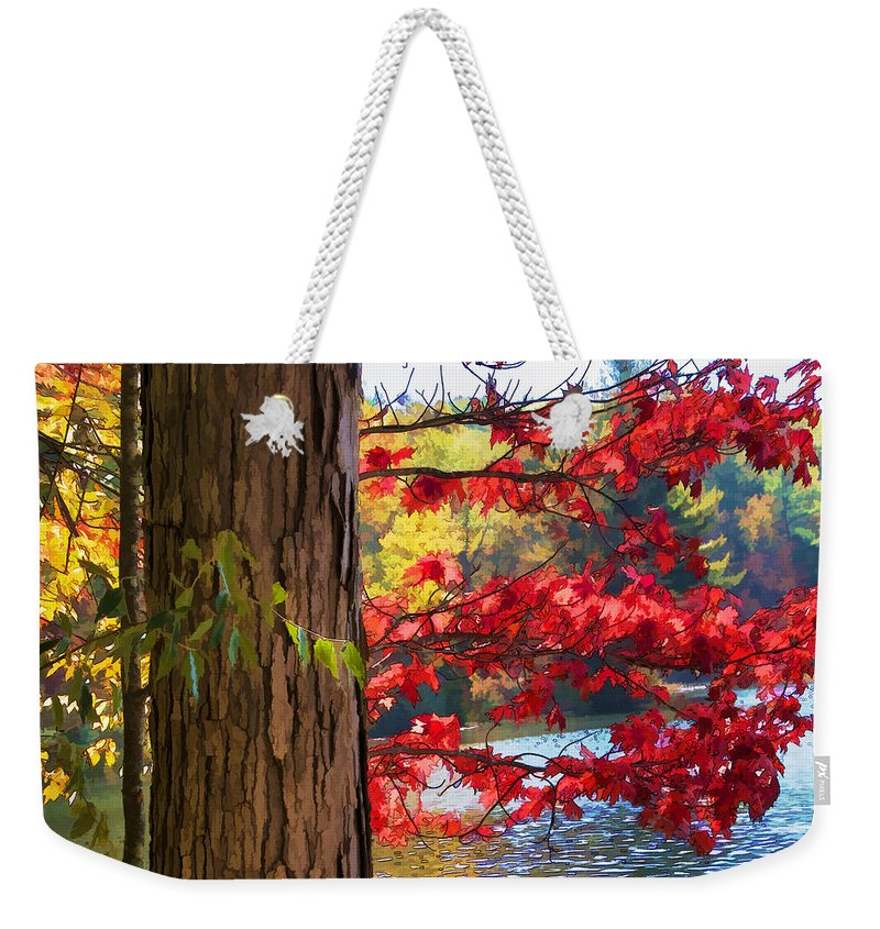 Beautiful Weekender Tote Bag featuring the photograph Painterly Rendition Of Red Leaves And Tree Trunk In Autumn by Randall Nyhof