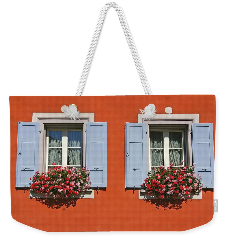 Red Weekender Tote Bag featuring the photograph Pair Of Blue Shutters by Tom Reynen