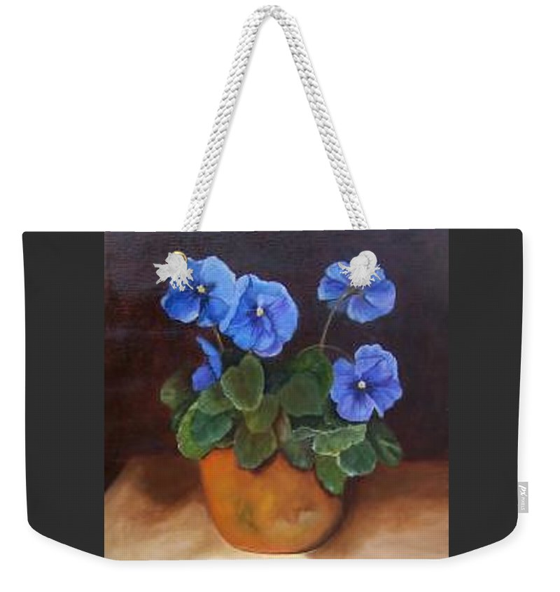 Blue And Purple Pansies In A Terracotta Pot Set Against A Dramatic Background Weekender Tote Bag featuring the painting Pansies In Terracotta by Susan Dehlinger