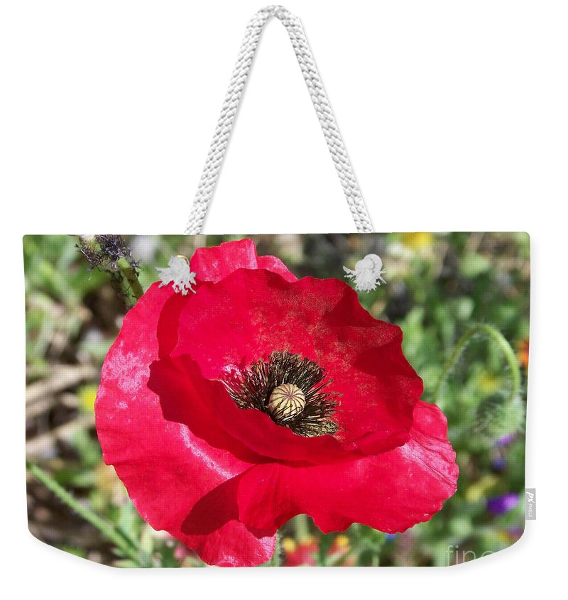 Red Weekender Tote Bag featuring the photograph Paper Flower by Kathy McClure