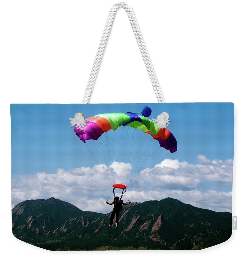 Parachuting Weekender Tote Bag featuring the photograph Parachuting by Mark Ivins