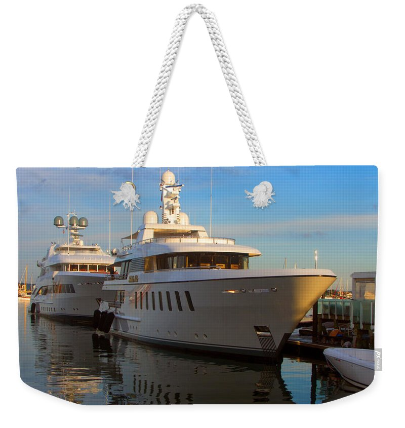 Parallel Weekender Tote Bag featuring the photograph Parallel Parked by Ray Konopaske