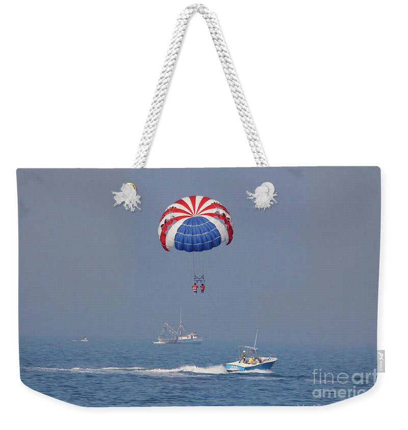 Ocean Weekender Tote Bag featuring the photograph Parasailing In Florida by Deborah Benoit