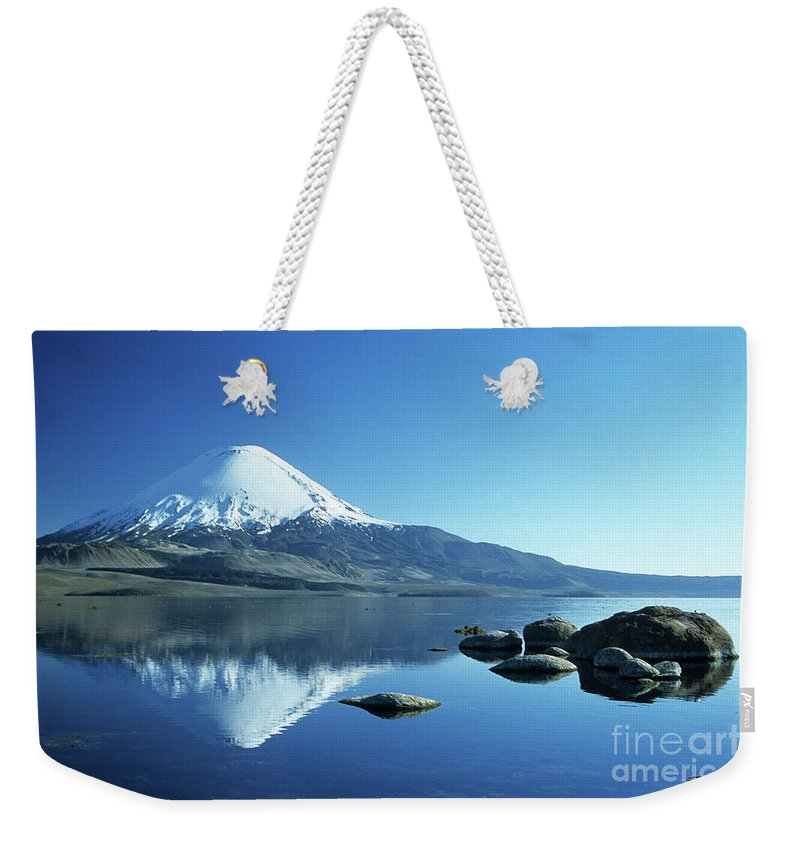 Chile Weekender Tote Bag featuring the photograph Parinacota Volcano Reflections Chile by James Brunker