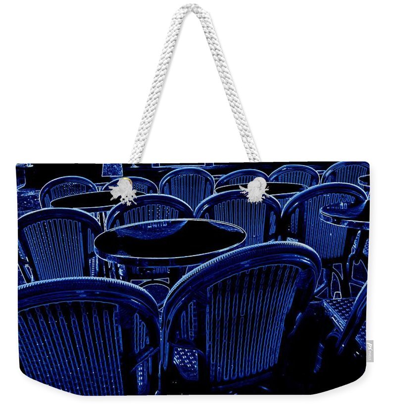 Neon Weekender Tote Bag featuring the photograph Paris Chairs by Jo Hoden