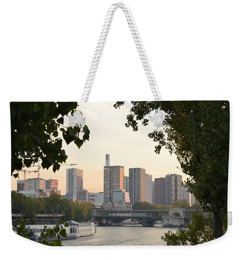 Paris Weekender Tote Bag featuring the photograph Paris Cityscape Across The Water by Dawn Crichton
