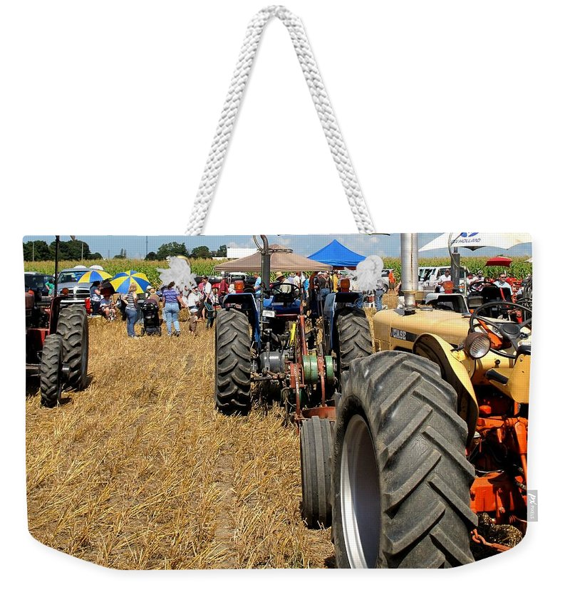Tractors Weekender Tote Bag featuring the photograph Parking For Lunch by Ian MacDonald