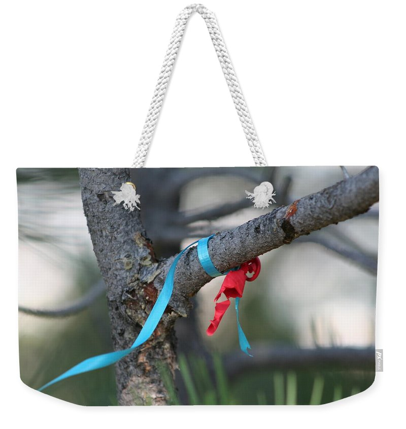 Broken Balloon Weekender Tote Bag featuring the photograph Party's Over by Ric Bascobert