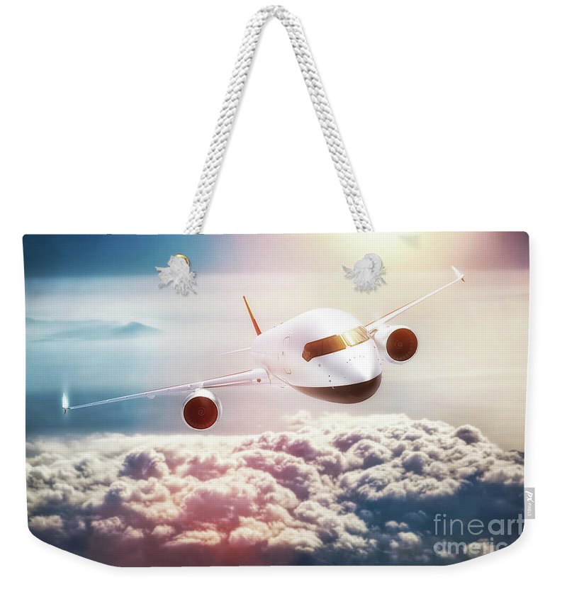 Airplane Weekender Tote Bag featuring the photograph Passenger Airplane Flying At Sunset, Blue Sky. by Michal Bednarek