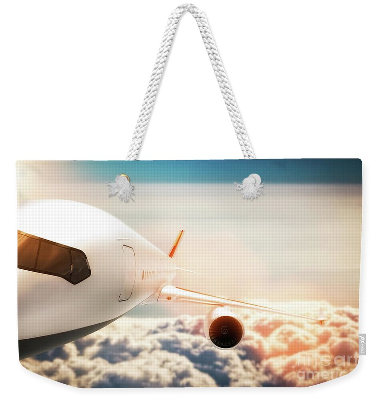 Airplane Weekender Tote Bag featuring the photograph Passenger Airplane Flying At Sunshine, Blue Sky. by Michal Bednarek