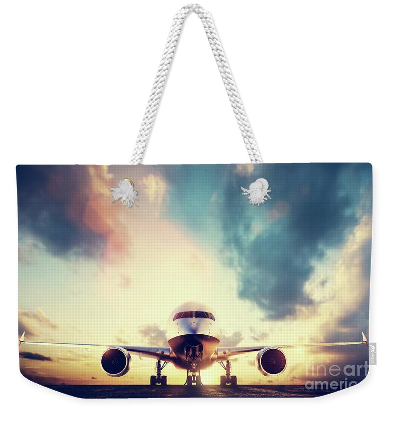 Airplane Weekender Tote Bag featuring the photograph Passenger Airplane Taking Off On Runway At Sunset by Michal Bednarek