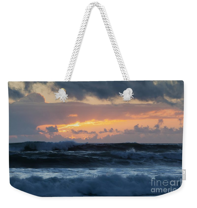 Sunset Weekender Tote Bag featuring the photograph Pastel Sunset Over Stormy Waves by Sharon Foelz
