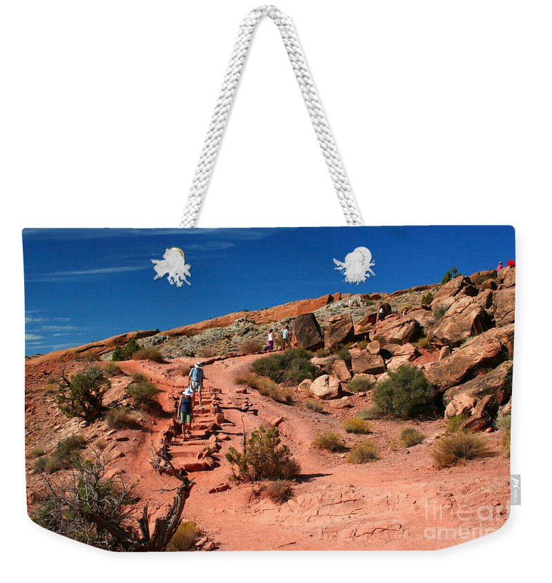 Double O Arch Weekender Tote Bag featuring the painting Path To Double O Arch Arches National Park by Corey Ford