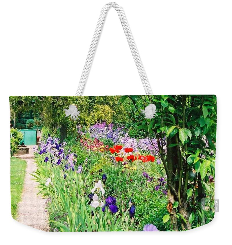 Claude Monet Weekender Tote Bag featuring the photograph Path To Monet's House by Nadine Rippelmeyer