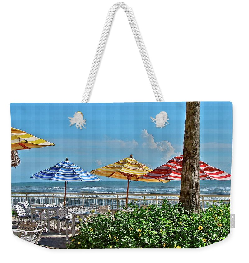 Sea Weekender Tote Bag featuring the photograph Patio Dining by Diana Hatcher
