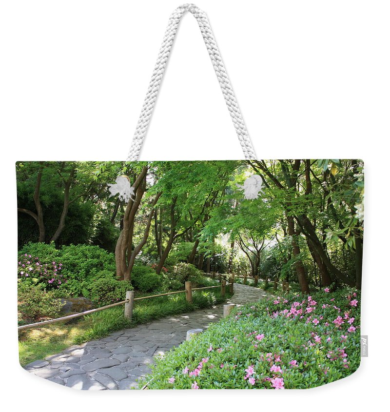 Garden Path Weekender Tote Bag featuring the photograph Peaceful Garden Path by Carol Groenen