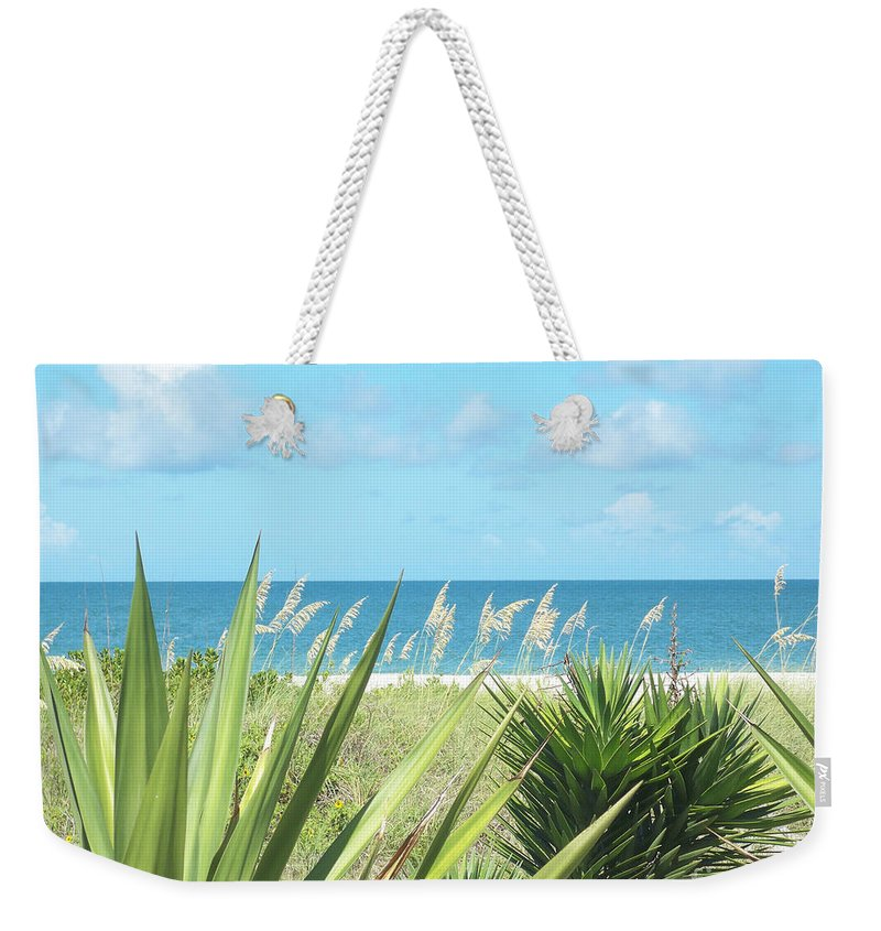 Florida Weekender Tote Bag featuring the photograph Peeking Sea by Chris Andruskiewicz