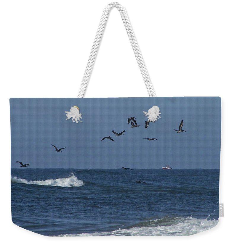 Pelicans Weekender Tote Bag featuring the photograph Pelicans Over The Atlantic by Teresa Mucha