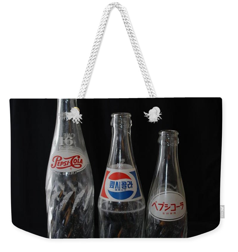 Pepsi Cola Weekender Tote Bag featuring the photograph Pepsi Bottles by Rob Hans