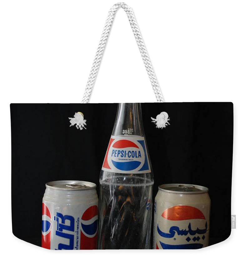 Cola Weekender Tote Bag featuring the photograph Pepsi Cola by Rob Hans