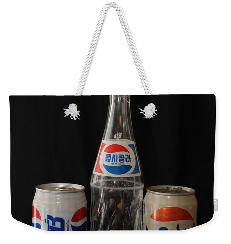 Korean Weekender Tote Bag featuring the photograph Pepsi From Around The World by Rob Hans