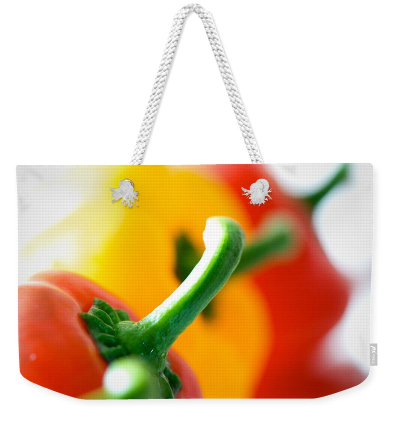 Pepper Weekender Tote Bag featuring the photograph Perfect Peppers by Lisa Knechtel