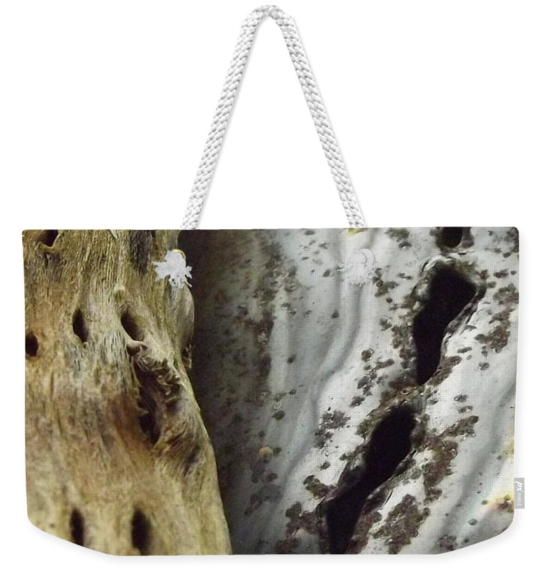 Holes Weekender Tote Bag featuring the photograph Perforations by Jerry Wilson
