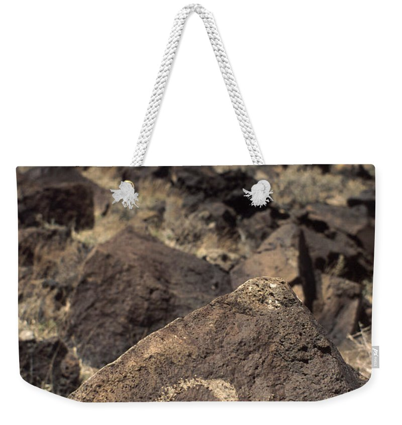 Petroglyph Weekender Tote Bag featuring the photograph Petroglyph by Jerry McElroy