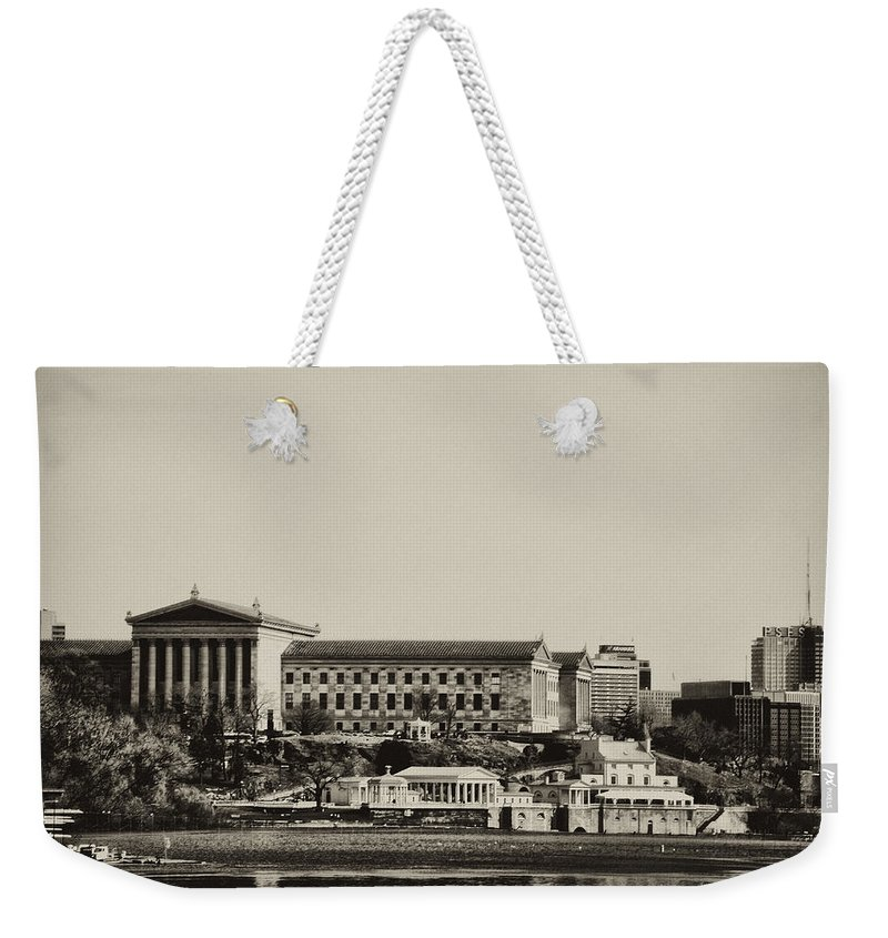 Philadelphia Weekender Tote Bag featuring the photograph Philadelphia Museum Of Art And The Fairmount Waterworks From West River Drive In Black And White by Bill Cannon