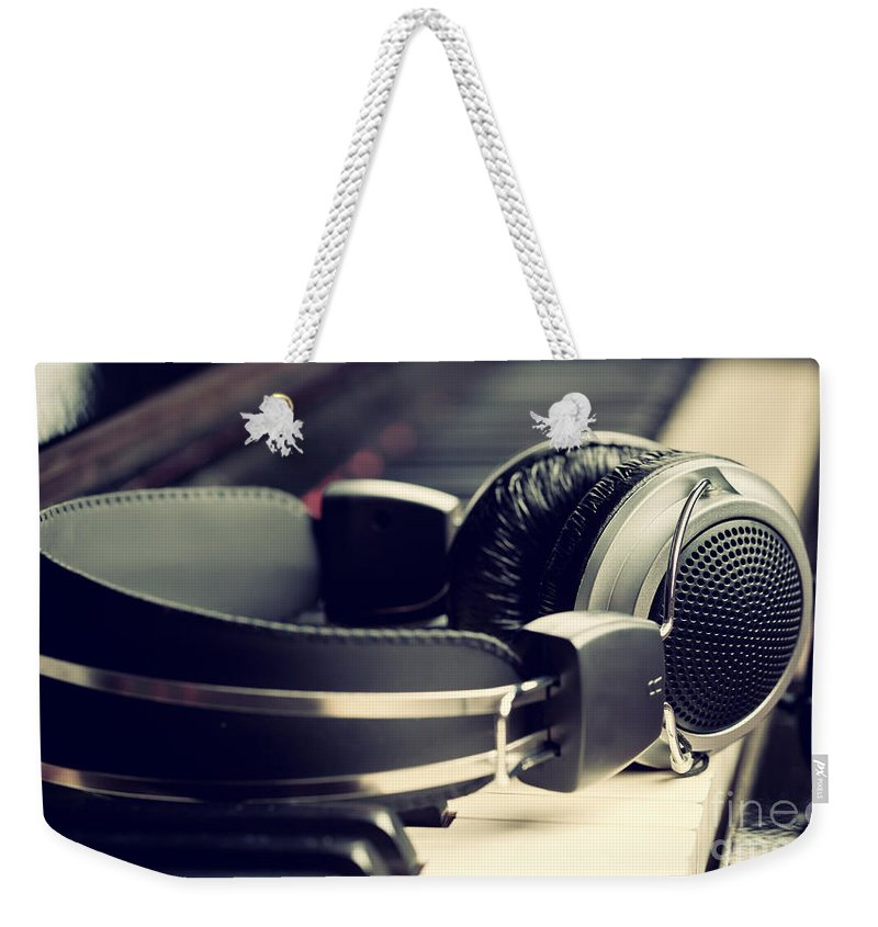 Piano Weekender Tote Bag featuring the photograph Piano Keyboard And Headphones by Antonio Gravante