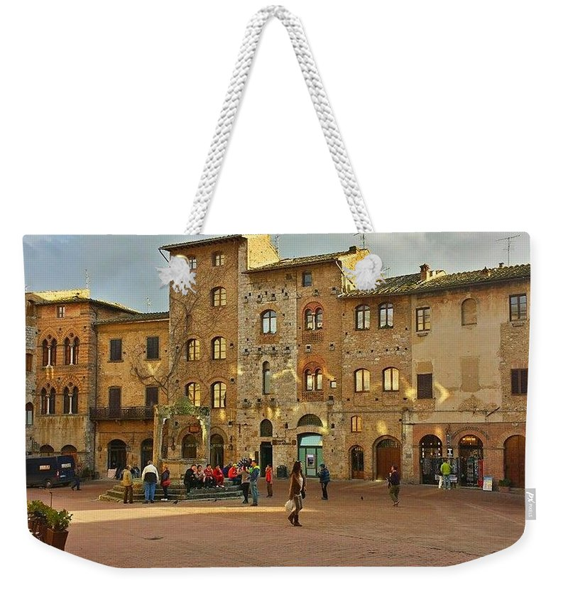 Large Stone And Brick Plaza Weekender Tote Bag featuring the photograph Piazza Della Cisterna by Harriet Harding
