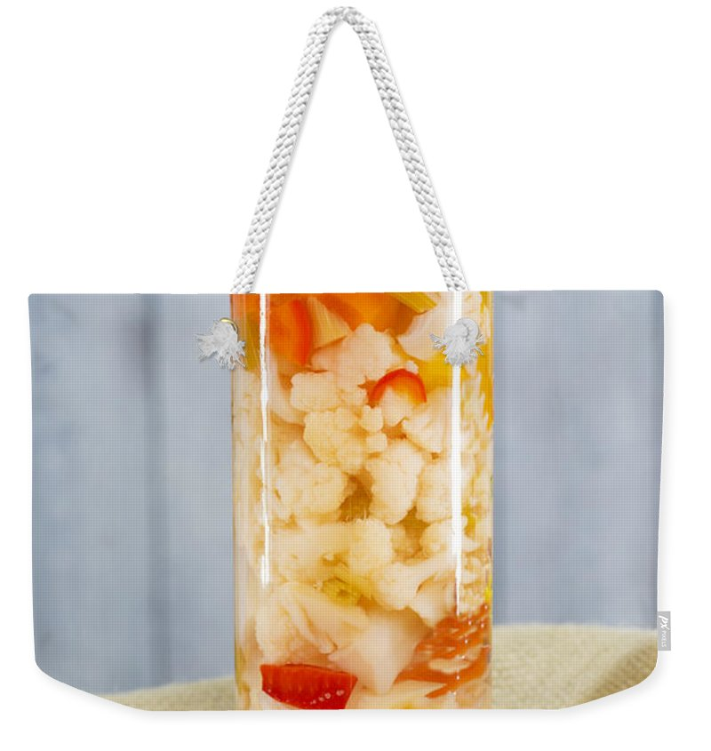 Pickled Weekender Tote Bag featuring the photograph Pickled Vegetables In Clear Glass Jar by Donald Erickson