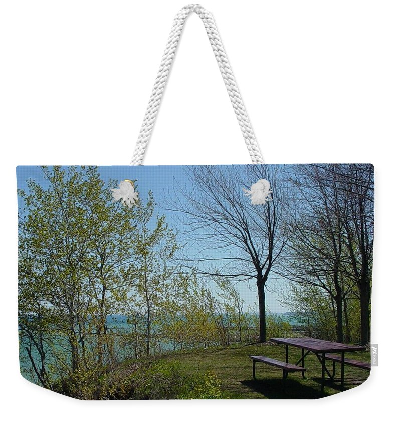 Lake View Weekender Tote Bag featuring the photograph Picnic Table By The Lake Photo by Anita Burgermeister