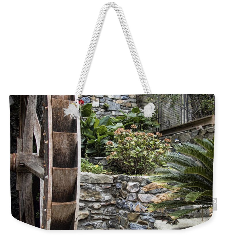 Water Weekender Tote Bag featuring the photograph Pictueresque Waterwheel In Cinqueterre Garden by David Smith