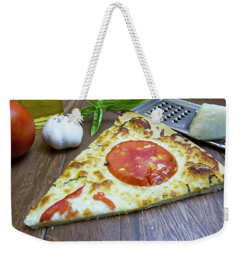 Baked Weekender Tote Bag featuring the photograph Piece Of Margarita Pizza With Fresh Ingredients by Karen Foley