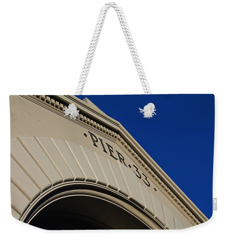 Pier 33 Weekender Tote Bag featuring the photograph Pier 33 by Michiale Schneider